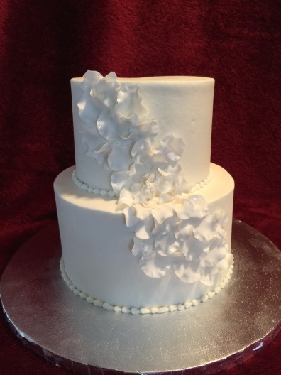 a mini version of the clients wedding cake